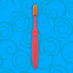 Detalle frontal de cepillo dental infantil